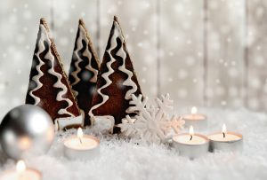 cookies in snow with candles and white decorations