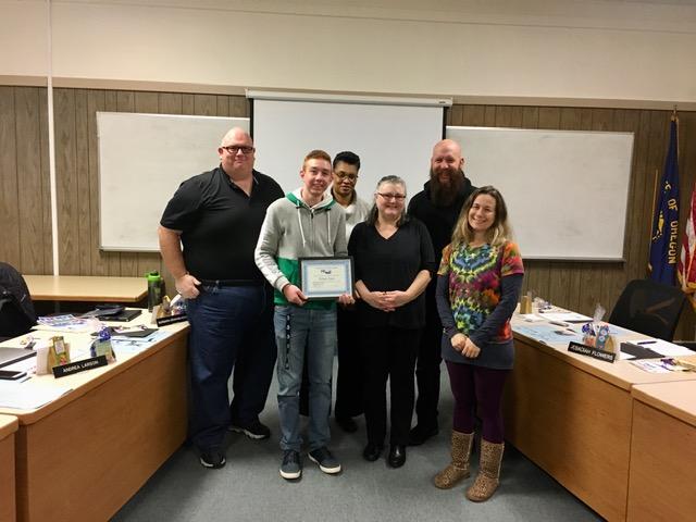 award winner with school board members