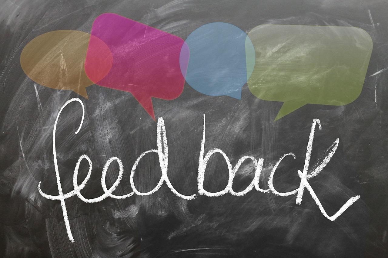 feedback written in chalk on a chalkboard